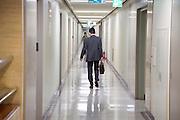 businessman walking through office hallway