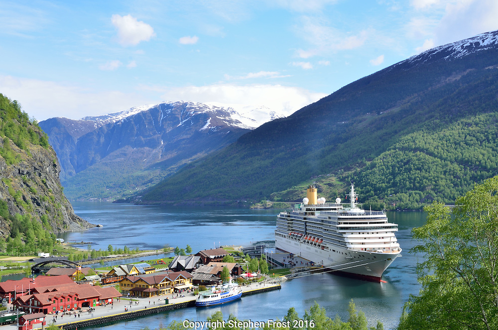 A Cruise ship docked in the village of Flåm in Norway. Flåm is a village at the inner end of the fjord of Aurlandsfjorden, an arm of Sognefjorden. The cruise ship is the Arcadia of the P & O cruise line.