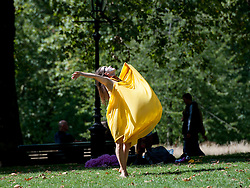 © Licensed to London News Pictures. 22/08/2015. London, UK. As the sun shines a women dances in Green Park. Photo credit: Pete Maclaine/LNP