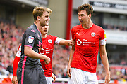 Leeds United forward Patrick Bamford (9) and Barnsley defender Aapo Halme (24) during the EFL Sky Bet Championship match between Barnsley and Leeds United at Oakwell, Barnsley, England on 15 September 2019.