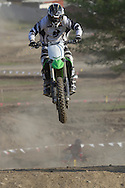 Middletown, New York - A rider flies through the air on a jump at Orange County Fair Motocross practice on May 14, 2014.