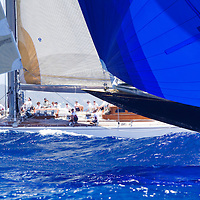 The sharp bow of the J Class yacht Valsheda noses past its competitor, Ranger, at the Antigua Classic Yacht Regatta. The event  is one of the worlds most prestigious traditional yacht races.