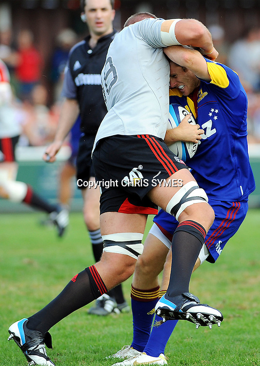 Crusader Luke Romano makes a tackle on Highlanders Chris Noakes during their Super Rugby Pre-season game Crusaders v Highlanders. Rugby Park, Greymouth, New Zealand. Friday 3 February 2012. Photo: Chris Symes/www.photosport.co.nz