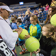 August 20, 2014, New Haven, CT:<br /> Samantha Stosur signs autographs after a match against Eugenie Bouchard on stadium court on day six of the 2014 Connecticut Open at the Yale University Tennis Center in New Haven, Connecticut Tuesday, August 20, 2014.<br /> (Photo by Billie Weiss/Connecticut Open)