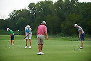 Golfers warm up before the Under Armour® / Jordan Spieth Championship presented by American Campus Communities at Trinity Forest Golf Club in Dallas, Texas on August 15, 2017. CREDIT: Cooper Neill for The Wall Street Journal<br /> JRGOLF