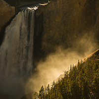 Sun shines through the spray of Yellowstone's Lower Falls