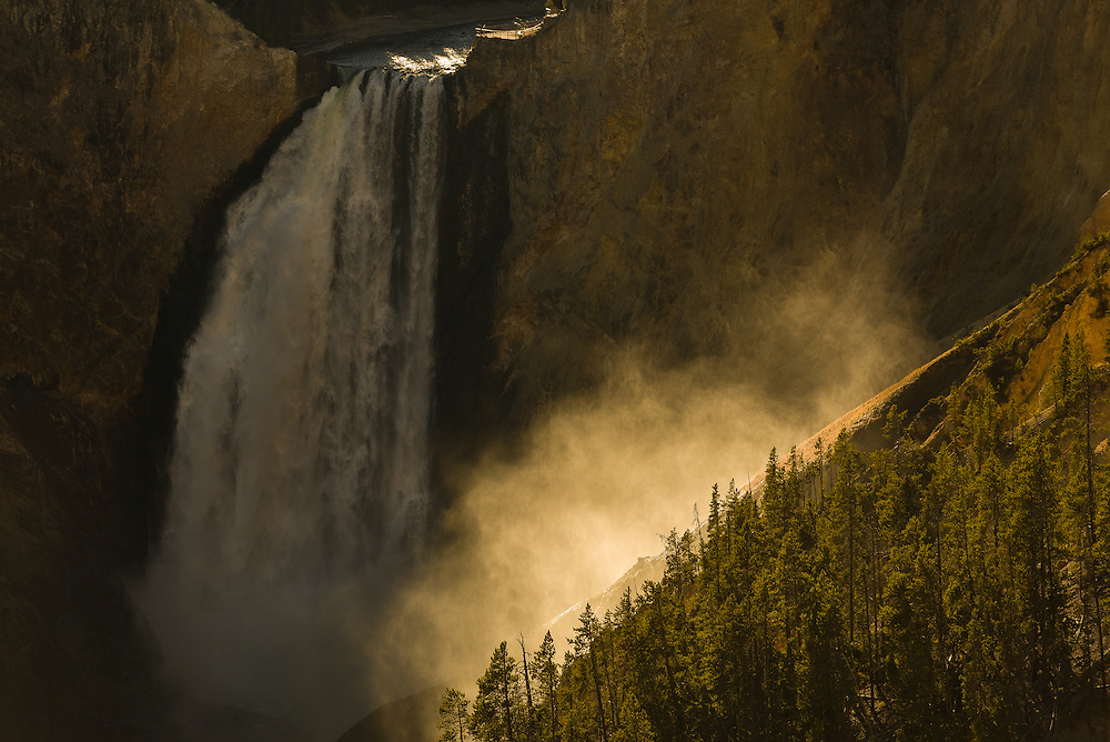 Sun shines through the spray of Yellowstone's Lower Falls