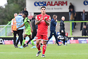 Reece Grego-Cox (7) of Crawley Town applauds the travelling fans at full time after the 3-1 loss during the EFL Sky Bet League 2 match between Forest Green Rovers and Crawley Town at the New Lawn, Forest Green, United Kingdom on 5 October 2019.
