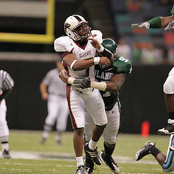 20 September 2008: Tulane defensive tackle Julian Shives-Sams (97) pressures Louisiana-Monroe quarterback Kinsmon Lancaster (7) during a Conference USA match up between the University of Louisiana Monroe and Tulane at the Louisiana Superdome in New Orleans, LA.