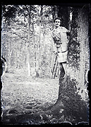 woman standing in a tree France circa 1930s
