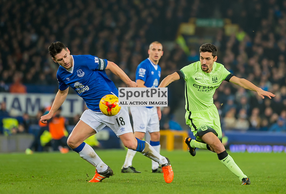Everton midfielder Gareth Barry and Manchester City midfielder Jesus Navas challenge for a loose ball in the Football League cup semi-final first leg at Goodison Park, Liverpool