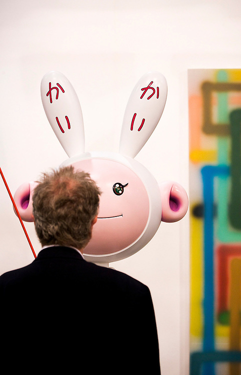 "Visitor face to face with  sculpture ""Kaikai Kiki"" by Takashi Murakami at Galerie Emmanuel Perotin, Art Basel Miami Beach 2007"