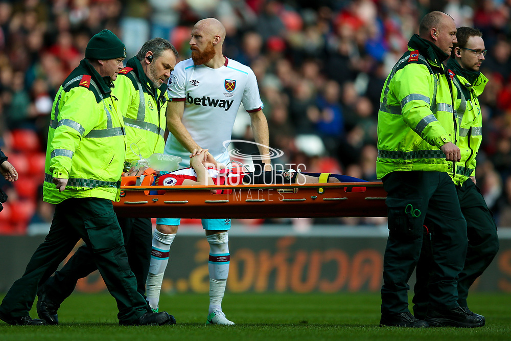 Sunderland defender Billy Jones (2) is stretchered off with oxygen during the Premier League match between Sunderland and West Ham United at the Stadium Of Light, Sunderland, England on 15 April 2017. Photo by Simon Davies.