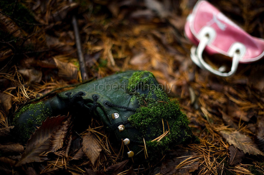 A shoe and a small bag lie among the undergrowth in Aokigahara Jukai, better known as the Mt. Fuji suicide forest, which is located at the base of Japan's famed mountain west of Tokyo, Japan on Dec 1 2009...