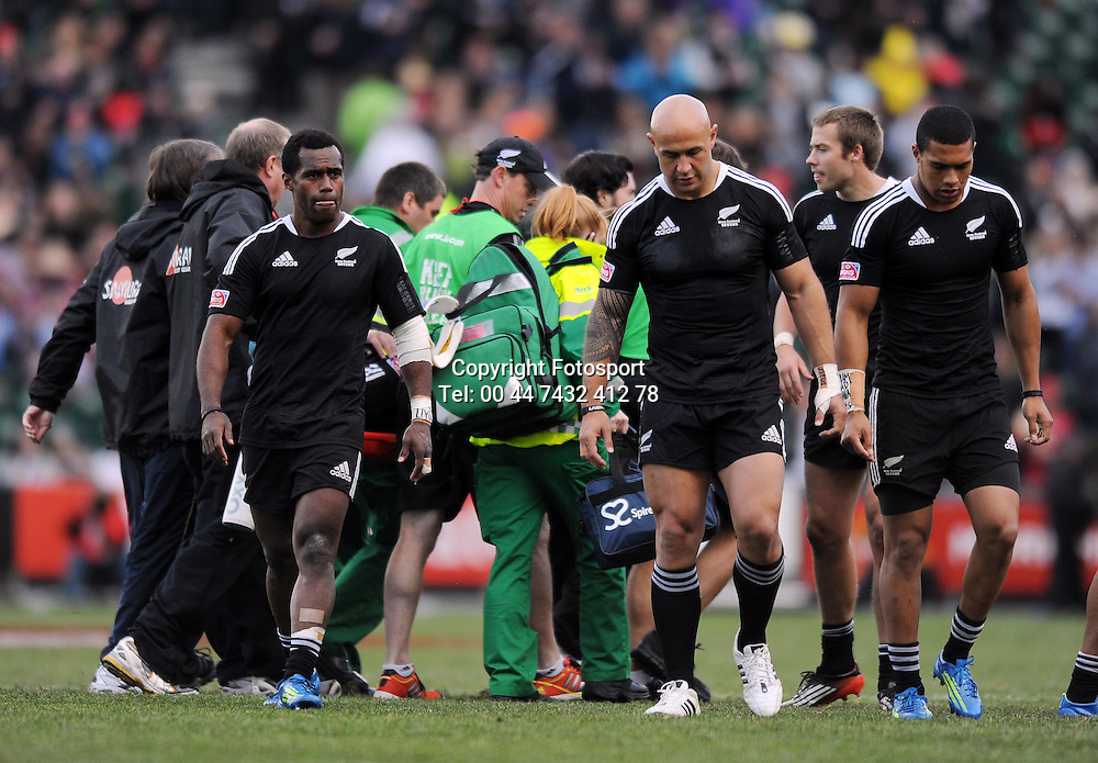 New Zealand's Bryce Heem (in the background) is carried off injured after taking a heavy fall in a tackle.<br /> New Zealand v England, Cup Final, IRB Sevens World Series, round 8, Day 2, Scotstoun Stadium, Glasgow, Scotland, Sunday 6th May 2012.<br /> PLEASE CREDIT ***FOTOSPORT/DAVID GIBSON***