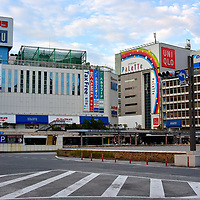 Odakyu Department Store at Shinjuku Station in Tokyo, Japan<br /> On the right is the 16 floor Odakyu Department Store. On the left is Odakyu HALC, their electronic and sporting goods annex. They are massive shopping complexes. How do they justify so much retail space? Easy! Below ground and adjacent is the Shinjuku Station. According to Guinness World Records, the 3.6 million passengers a day qualify Shinjuku-eki as the world&rsquo;s largest transportation hub.