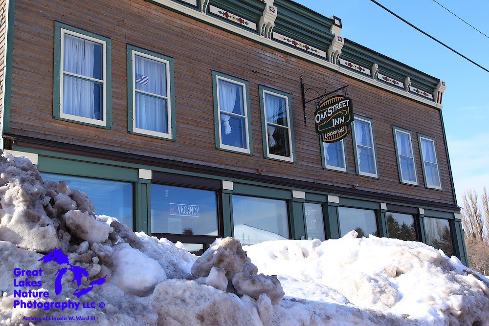 Another of Calumet's beautiful buildings is the Oak Street Inn. Although it originally housed a tavern and grocery store on it's lower level, it lives on as a large group lodging facility with three huge private suites. The front of this building is beautiful, with styling touches similar to those of many of Calumet's old commercial buildings. This is a terrific example of how Calumet's new business community is investing in the area's architectural legacy while creating new economic activity in the town.