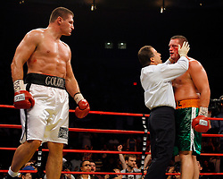 October 6, 2007; New York, NY, USA; Andrew Golota (white trunks) looks on as referee Arthur Mercante Jr. stops Kevin McBride (Green Trunks)  during their heavyweight bout at Madison Square Garden.