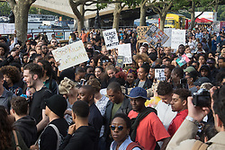 London, July 8th 2016. Hundreds gather on London's Southbank before marching through the streets of London to Parliament Square, Downing Street and the BBC, in a Black Lives Matter protest in solidarity with Americans following the shooting dead of two black men, Philando Castile in Minnesota and Alton Sterling in Louisiana by police in the US. PICTURED: The crowd prepares to march from Southbank to Parliament Square.