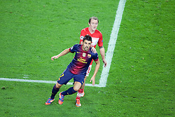 David Villa is held back by Aiden McGeady during the Group G UEFA Champions League match between FC Barcelona and Spartak Moscow at the Nou Camp, Barcelona, Spain 19th September 2012. Credit - Eoin Mundow/Cleva Media
