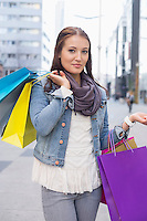 Portrait of beautiful woman carrying shopping bags