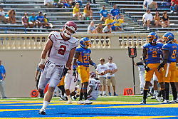 September 24, 2011; San Jose, CA, USA;  New Mexico State Aggies quarterback Matt Christian (2) celebrates after scoring a touchdown against the San Jose State Spartans during the third quarter at Spartan Stadium. San Jose State defeated New Mexico State 34-24.