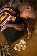 A girl uses shells and sticks to count during a math class at the Essaout primary school in the village of Essaout, Senegal, on Thursday June 14, 2007...