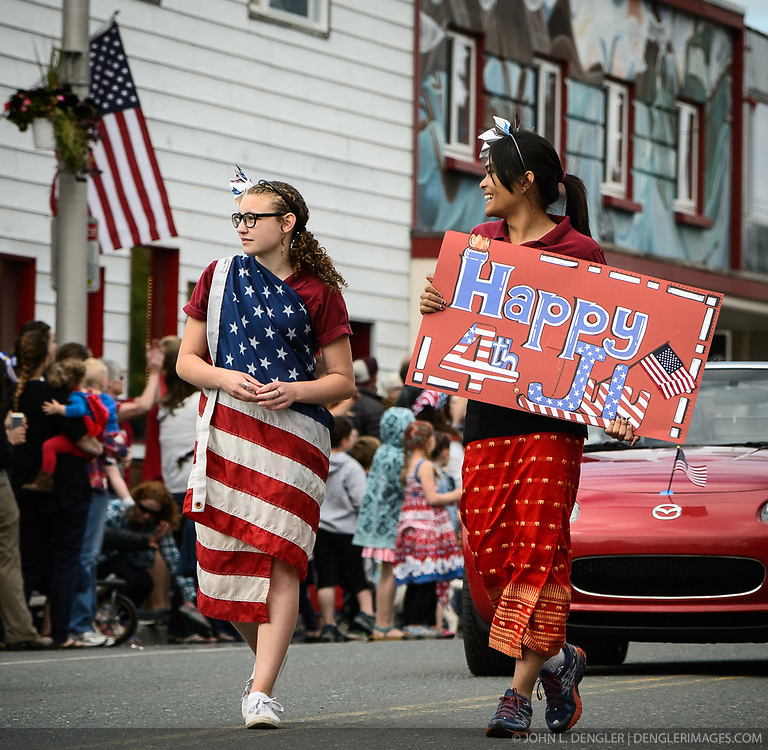 The town of Haines, in southeast Alaska, celebrates the Fourth of July with a parade, picnic, and other activities. Here two unidentified parade marchers make their way down Main St.<br /> <br /> Haines, a picturesque costal fishing community, is located on the Lynn Canal between the towns of Skagway and Juneau.