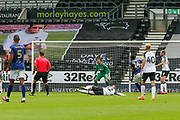 Wayne Rooney of Derby County blocks a shot by Josh Dasilva of Brentford during the EFL Sky Bet Championship match between Derby County and Brentford at the Pride Park, Derby, England on 11 July 2020.