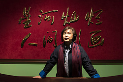 """© Licensed to London News Pictures. 03/03/2020. LONDON, UK. Cao Fei poses with her installation """"RMB City: A Second Life City Planning"""", 2008. Preview of """"Blueprints"""" by Cao Fei, a Chinese multi-media artist and filmmaker, based in Beijing.  The exhibition is the artist's first large-scale solo show in the UK, features works from 2006-2020 including her first virtual reality work. The show takes place at the Serpentine Gallery 4 March to 17 May 2020.  Photo credit: Stephen Chung/LNP"""