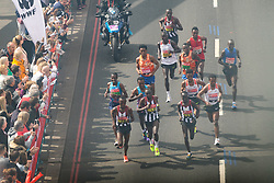 © Licensed to London News Pictures. 23/04/2017. LONDON, UK.  Leading elite men run across Tower Bridge seen from the glass walkway of Tower Bridge, as runners reach the half way point.  Photo credit: Vickie Flores/LNP