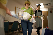 Garret County Community Action Non-Profit...Sheila Ford, Food Service Manager, helps volunteers pack up meals to be delivered to the local elderly population...Images of the Garrett County Community Action-Area Agency on Aging..Home Delivered Meals:.A nutritionally balanced meal is delivered to frail homebound elderly five days a week...Support Services:.Social, recreational, educational opportunities, trips, legal assistance are offered to older adults at Senior Centers and Eating Together Sites. A telephone reassurance service for homebound elderly is available as well as a cellular phone loaner program.