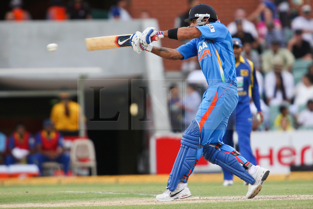 © Licensed to London News Pictures. 14/02/2012. Adelaide Oval, Australia. Virat Kohli plays a pull shot during the One Day International cricket match between India Vs Sri Lanka. Photo credit : Asanka Brendon Ratnayake/LNP
