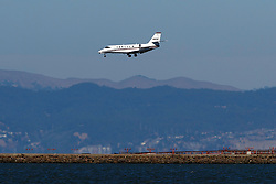 Cessna 680 Citation Sovereign (N387QS) operated by NetJets on approach to San Francisco International Airport (KSFO), San Francisco, California, United States of America