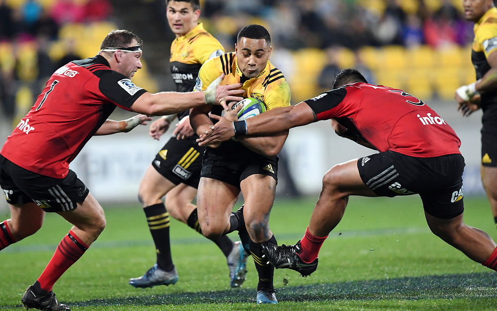 Hurricanes Ngani Laumape, centre, splits the defence of Crusaders Wyatt Crockett, left and Michael Alaalatoa in Super Rugby match at Westpac Stadium, Wellington, New Zealand, Saturday, July 15, 2017. Credit:SNPA / Ross Setford  **NO ARCHIVING""
