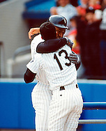 CHICAGO- APRIL 19: Bo Jackson of the Chicago White Sox is greeted by Ozzie Guillen after hitting a home run in his first at-bat after undergoing hip replacement surgery versus the New York Yankees at Comiskey Park in Chicago Illinois on April 19, 1993. (Photo by Ron Vesely)