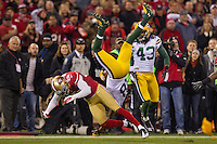 12 January 2013: Wide receiver (18) Randall Cobb of the Green Bay Packers gets flipped in the air during a kickoff by (20) Perrisk Cox of the San Francisco 49ers during the first half of the 49ers 45-31 victory over the Packers in an NFL Divisional Playoff Game at Candlestick Park in San Francisco, CA.