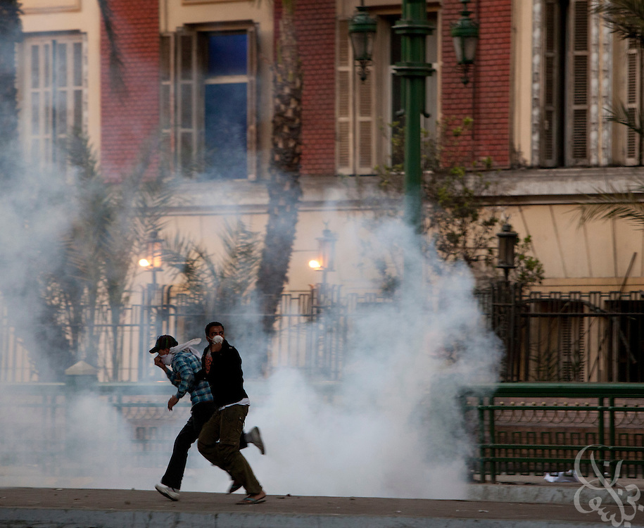 Rioting Egyptian teenagers flee cloud of tear gas fired by Egyptian riot police during continuing January 26, 2011 demonstrations in downtown Cairo, Egypt. A series of unprecedented demonstrations have broken out across Egypt for the past two days, inspired by the revolution in Tunisia, and intended to spark a similar movement in Egypt. (Photo by Scott Nelson)