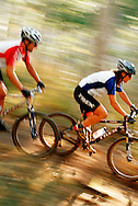mountain biker riding fast in forest at Deer Valley, UT USA