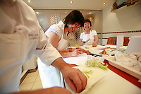 "Lenotre Ecole Culinaire, Paris,..short course - ""Return to the Market"" with Chef Jacky Legras..slicing onions..photo by Owen Franken for the NY Times..July 12, 2007......."