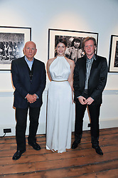Left to right, photographer SEBASTIAO SALGADO, GEMMA ARTERTON and PER ANDERS PETTERSSON at a private view of AMAZON an exhibition of photographs in aid of 'Sky Rainforest Rescue' held in the East Wing Galleries, Somerset House, London on 1st November 2011.
