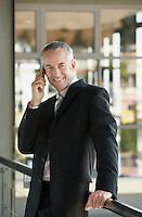 Businessman using mobile phone.
