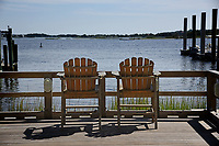 Chairs along the Swansboro waterfront await someone to sit.