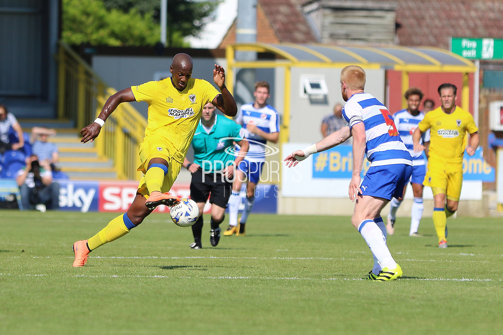 AFC Wimbledon striker Tom Elliott (9) during the Pre-Season Friendly match between AFC Wimbledon and Reading at the Cherry Red Records Stadium, Kingston, England on 23 July 2016. Photo by Stuart Butcher.