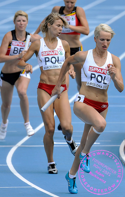 (L) ANETA JAKOBCZAK & (R) ANNA JESIEN (MAIDEN NAME: OLICHWIERCZUK ) (BOTH POLAND) COMPETE IN THE WOMEN'S RELAY 4 X 400 METERS DURING THE 2010 EUROPEAN ATHLETICS CHAMPIONSHIPS AT OLYMPIC STADIUM IN BARCELONA, SPAIN...SPAIN , BARCELONA , JULY 31, 2010..( PHOTO BY ADAM NURKIEWICZ / MEDIASPORT )..PICTURE ALSO AVAIBLE IN RAW OR TIFF FORMAT ON SPECIAL REQUEST.