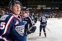 KELOWNA, CANADA - MARCH 4: Kyle Olson #25 stands on the bench during first period celebrating a goal with Brett Leason #29 of the Tri-City Americans against the Kelowna Rockets on March 4, 2017 at Prospera Place in Kelowna, British Columbia, Canada.  (Photo by Marissa Baecker/Shoot the Breeze)  *** Local Caption ***