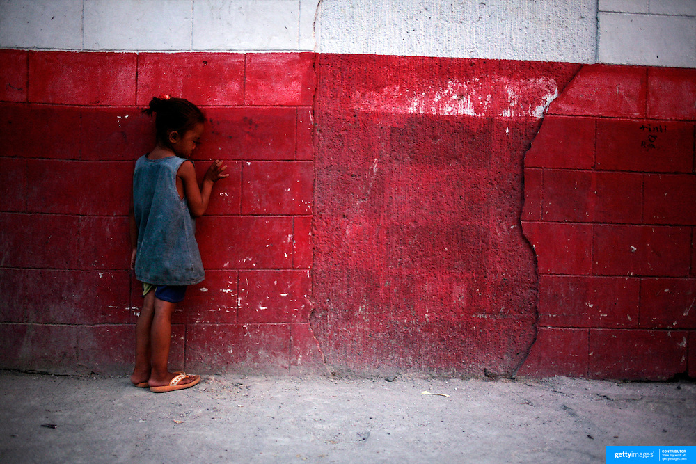 A young girl appearing sad in a street in Malate, Manila on September 18, 2008 in Adriatico Street, Malate, Manila, the Philippines. Photo Tim Clayton