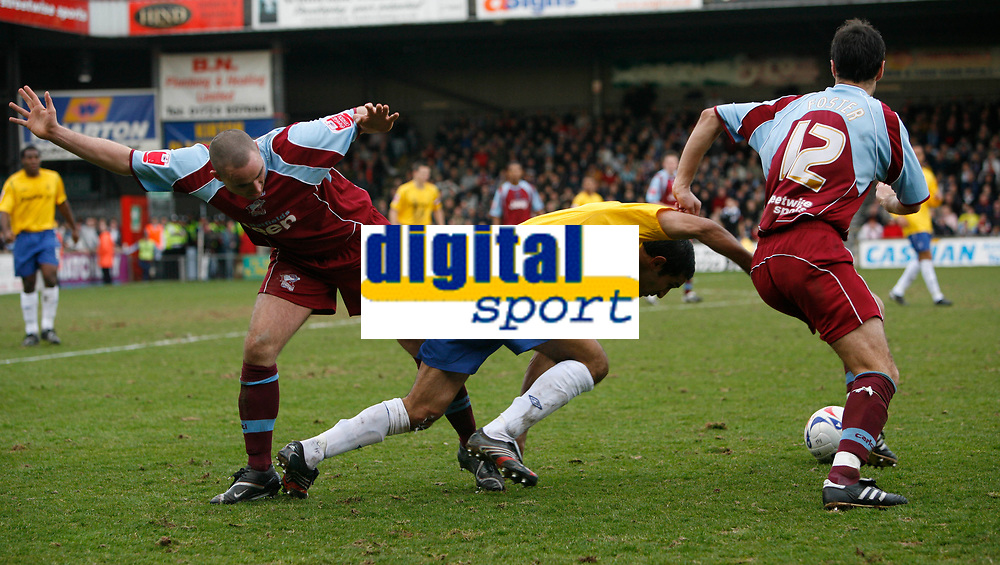 Photo: Steve Bond.<br />Scunthorpe United v Nottingham Forest. Coca Cola League 1. 10/03/2007. Jack Lester (centre) loses out to Scunthorpe defenders Lee Ridley (left) and Stepehen Foster (right)
