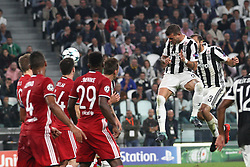 September 27, 2017 - Turin, Italy - Juventus midfielder Stefano Sturaro (27) heads the ball during the Uefa Champions League group stage football match n.2 JUVENTUS - OLYMPIACOS on 27/09/2017 at the Allianz Stadium in Turin, Italy. (Credit Image: © Matteo Bottanelli/NurPhoto via ZUMA Press)