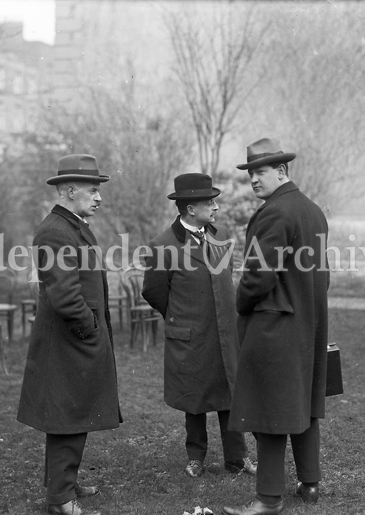 L-R: Eamon Duggan, Arthur Griffith, and Michael Collins, possibly in Hans Place, London. All three were members of the Irish delegation to London that negotiated the Anglo-Irish Treaty in 1921. The delegates lodged at Hans Place, near Hyde Park.<br />